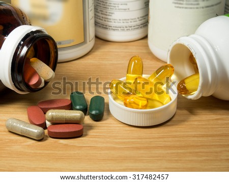 group of Vitamin with pill box,pill box,Vitamin,drug,multivitamin, herbal supplement capsules,fish oil,Natural organic green algae tablets,Colorful,pills and tablets - stock photo