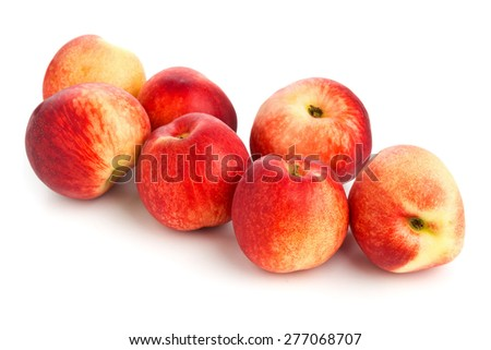 Group of whole uncut white nectarines on white background - stock photo