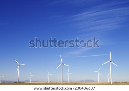 group of windmills for electric power generation alternative in Cuarte de Huerva, Saragossa, Aragon, Spain - stock photo