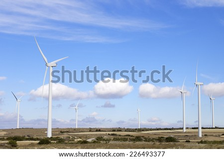 group of  windmills for renewable electric  energy production in Fuendetodos, Zaragoza, Aragon, Spain - stock photo
