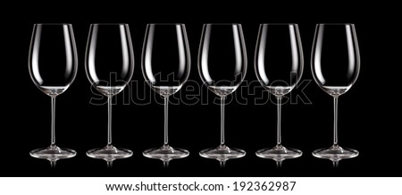 Group of wine glasses standing in a row - stock photo