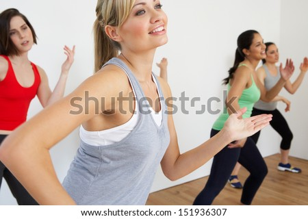 Group Of Women Exercising In Dance Studio - stock photo