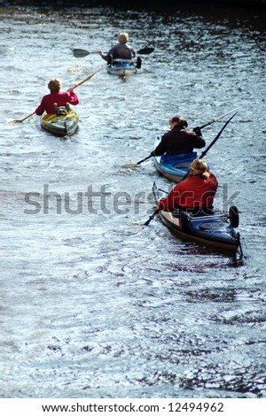 Group of women in canoes - stock photo