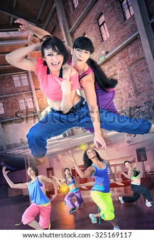 group of  women in sport dress dancing aerobics - stock photo