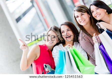 Group of women shopping at the mall - stock photo