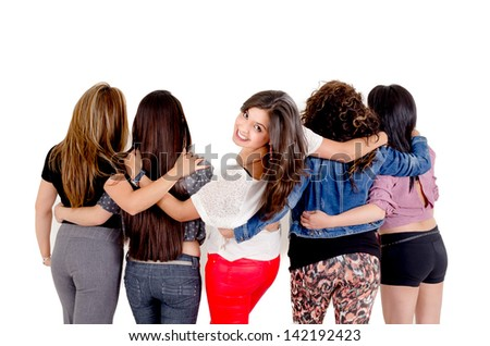 Group of women walking over a white background with one smiling and looking at the camera - stock photo