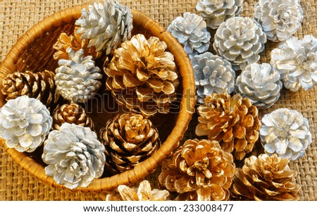 Group of yellow and white pine cone in art basket, this cone to decorate for Xmas season, in brown color make abstract symbol for Christmas eve - stock photo