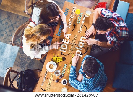 Group of young and creative people at the table, talking, planing, idea - stock photo