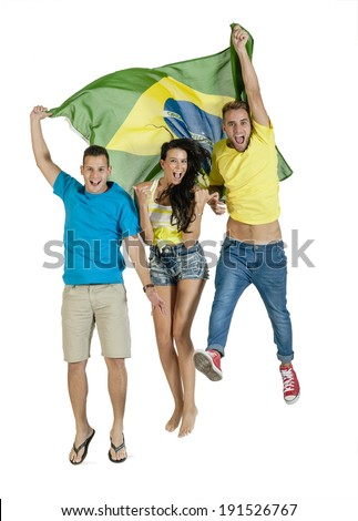 Group of young attractive football supporters jumping with Brazil Flag - stock photo