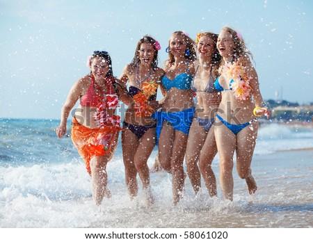 Group of young beautiful girls having fun at beach - stock photo