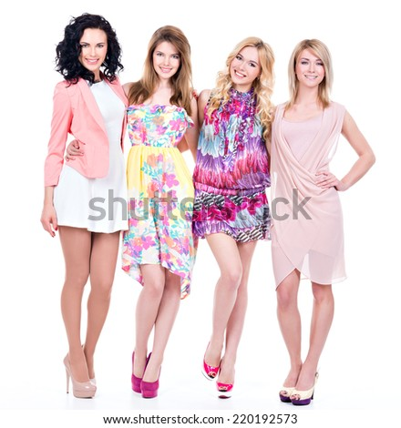 Group of young beautiful happy women in full length - isolated on white. - stock photo