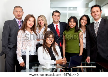 Group of young business people at the office - stock photo