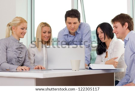 Group of young business people working in the office - stock photo