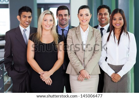 group of young businesspeople standing together in office - stock photo