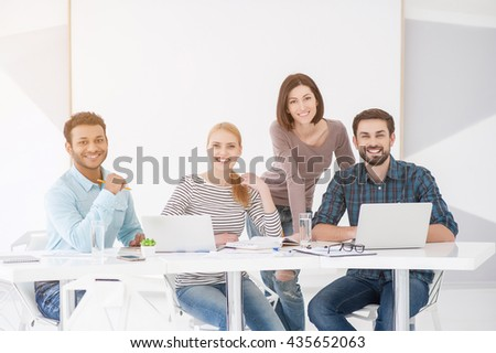 Group of young colleagues having meeting at office - stock photo