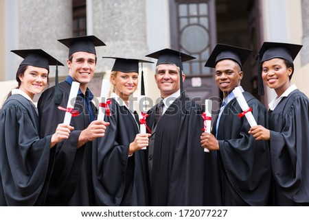 group of young college graduates and professor at graduation - stock photo
