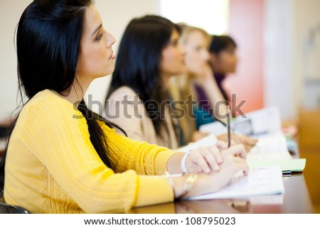 group of young college students in classroom - stock photo