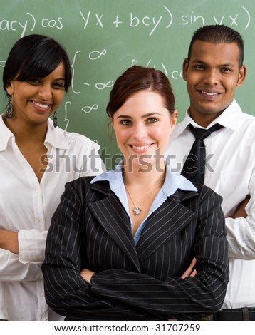 group of young confident school teachers in classroom - stock photo