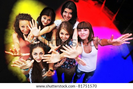 Group of young friends dancing at a night club - stock photo