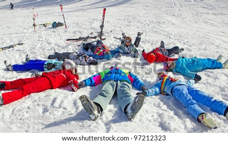 Group of young friends enjoying wintertime - stock photo