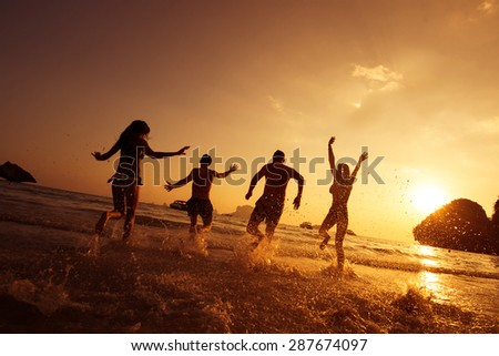 Group of young friends having fun on the beach. Phranang beach, Krabi province, Thailand - stock photo
