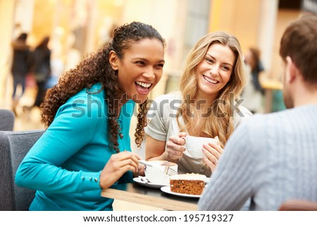 Group Of Young Friends Meeting In Cafe - stock photo