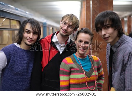 Group of young friends on subway station - stock photo