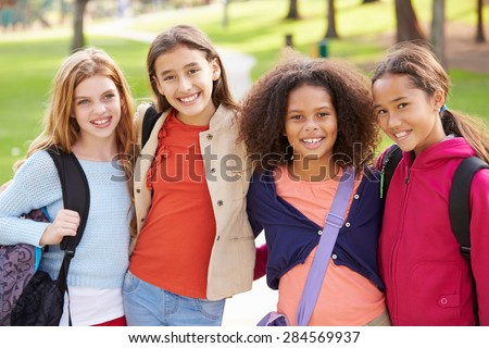 Group Of Young Girls Hanging Out In Park Together - stock photo