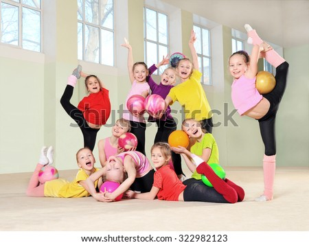 Group of young gymnasts in gym - stock photo