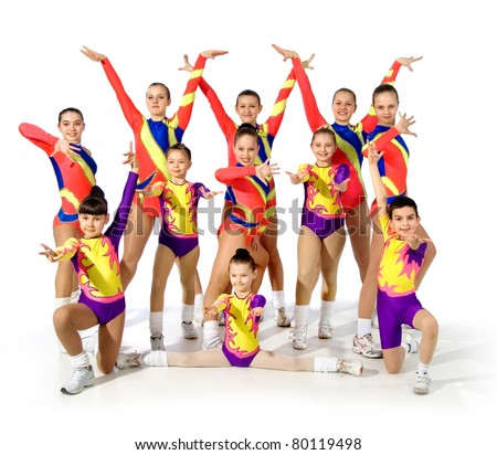 group of young gymnasts on a white background.sporting exercise.plastic study.aerobics.flexibility.sport.active rest. - stock photo