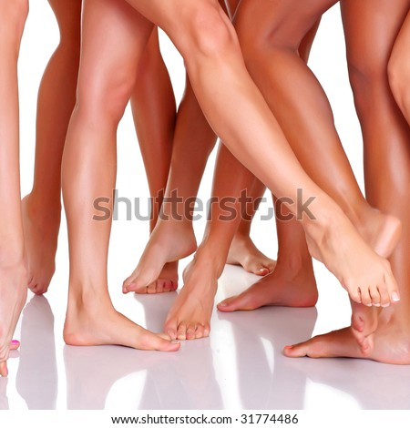 Group of young harmonous women shows the long sexual feet, isolated on a white background, please see some of my other parts of a images   - stock photo