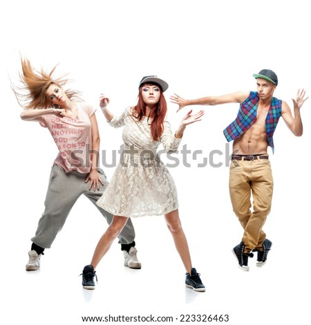 group of young hip hop dancers isolated on white background - stock photo