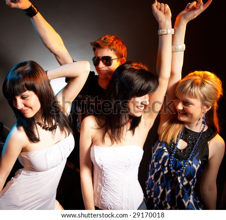 group of young modern caucasian people at the disco - stock photo