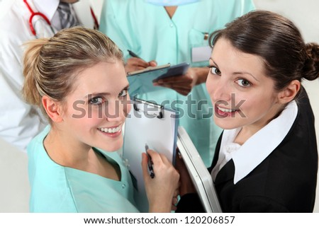 Group of young nurses - stock photo