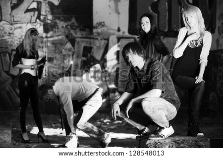 Group of young people at abandoned apartment - stock photo