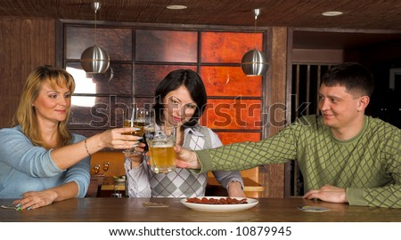 group of young people at the restaurant - stock photo