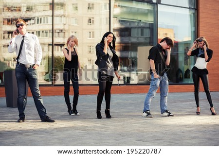 Group of young people calling on the cell phones - stock photo