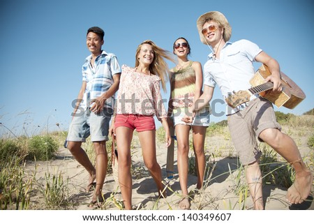 group of young people camping or going on a day trip - stock photo