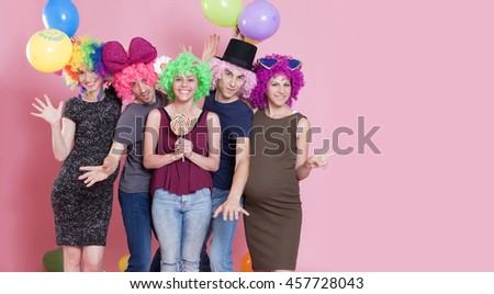 Group of young people disguised for a party. Large copy space on right. - stock photo