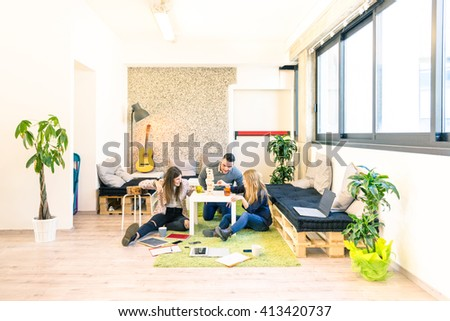 Group of young people employee workers having a break in start up office - Business concept of human resource and fun on working time - Start up entrepreneurs playing wood game - Bright vintage filter - stock photo