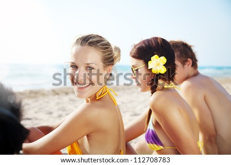 group of young people enjoying the beach - stock photo