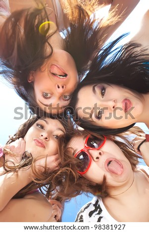 group of young people happily and closely hugging skyline - stock photo