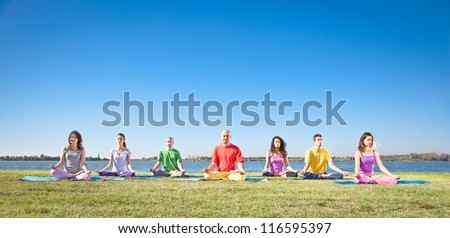 Group of young people have meditation on yoga class - stock photo