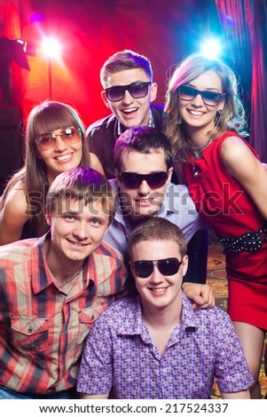 Group of young people having fun dancing at  party. - stock photo