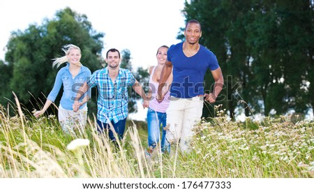 Group of young people having fun outside - stock photo