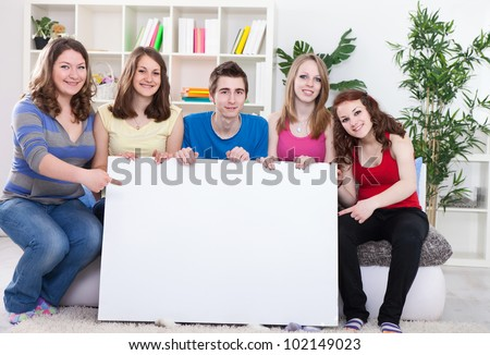 group of young people holding  the empty board - stock photo