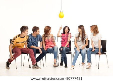 group of young people looking amazed at girl having an idea - stock photo