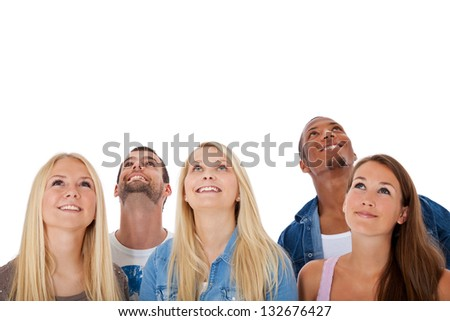 Group of young people looking up. All on white background. - stock photo