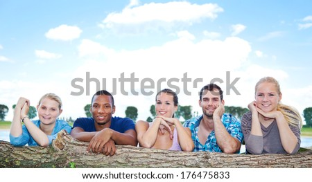 Group of young people outside - stock photo