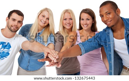 Group of young people putting hands together. All on white background. - stock photo